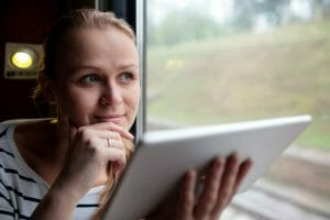 Woman with laptop creating an online business after age 50.