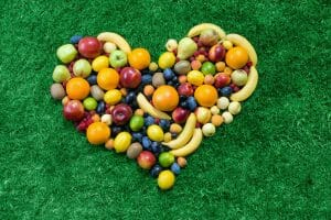 Healthy heart/Fruit heart lying on grass/sanespaces.com