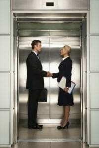 Businesspeople Shaking Hands in Elevator, employer and employee relationship