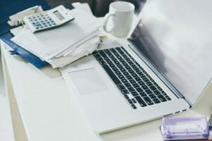 startup business, Cup of coffee, documents and laptop on the table of business person